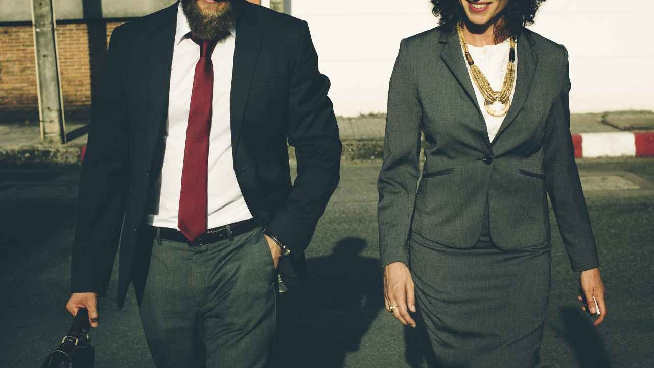 man and woman business attire Soft Skills vs Technical Skills